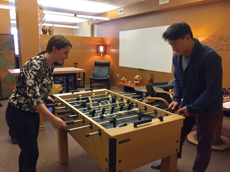 Paige and John playing foosball